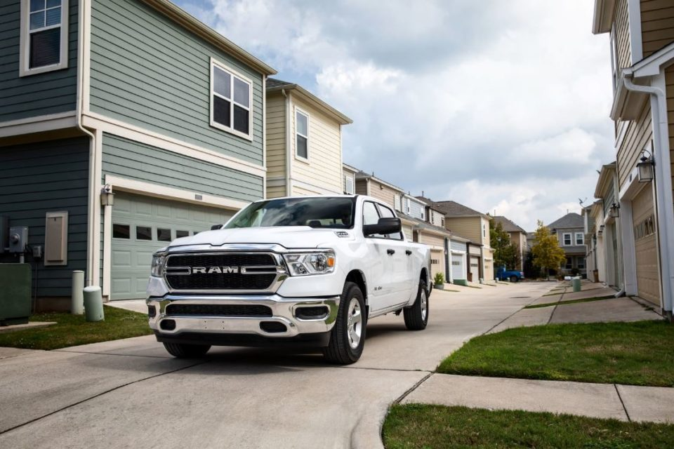 White RAM 1500 parked in a neighborhood