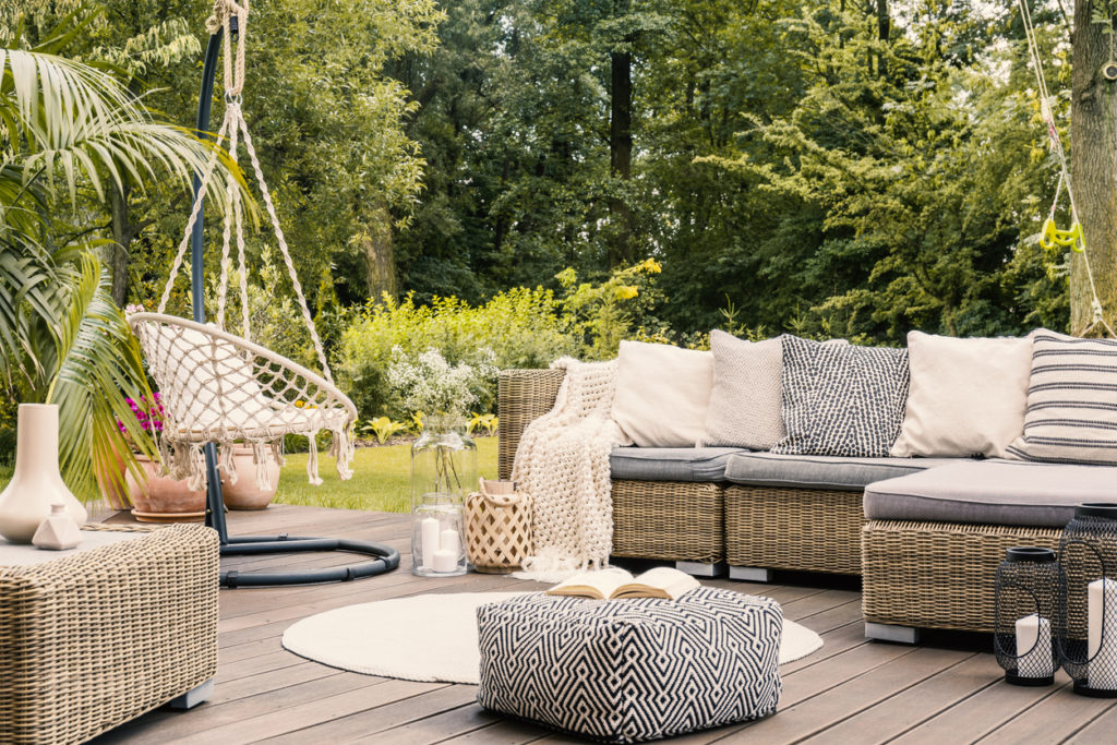 Patio set up with outdoor furniture and decorations
