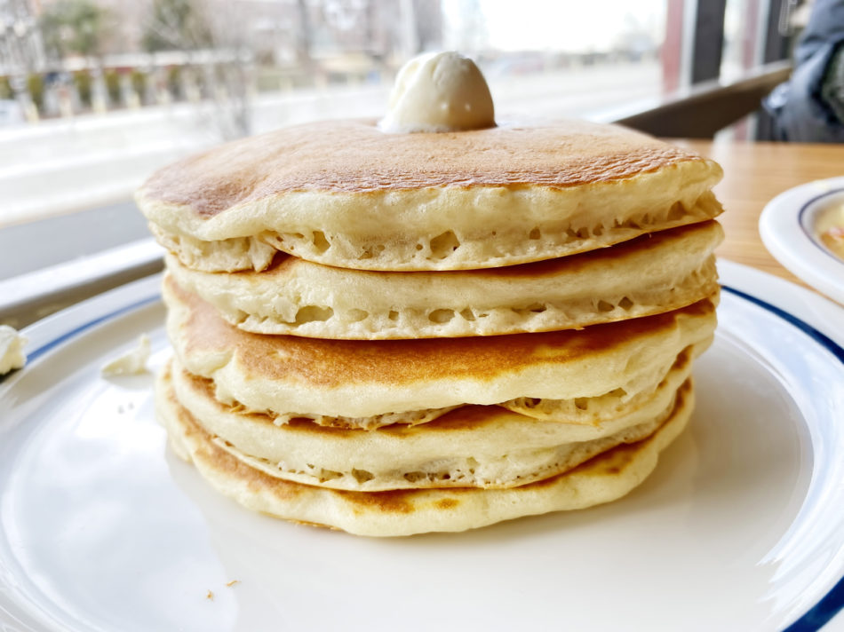 Buttermilk pancakes on a diner table