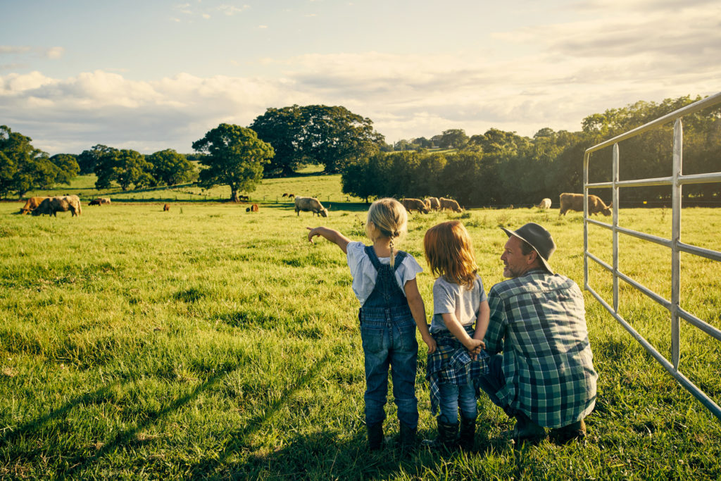 farmer and his kids on their farm
